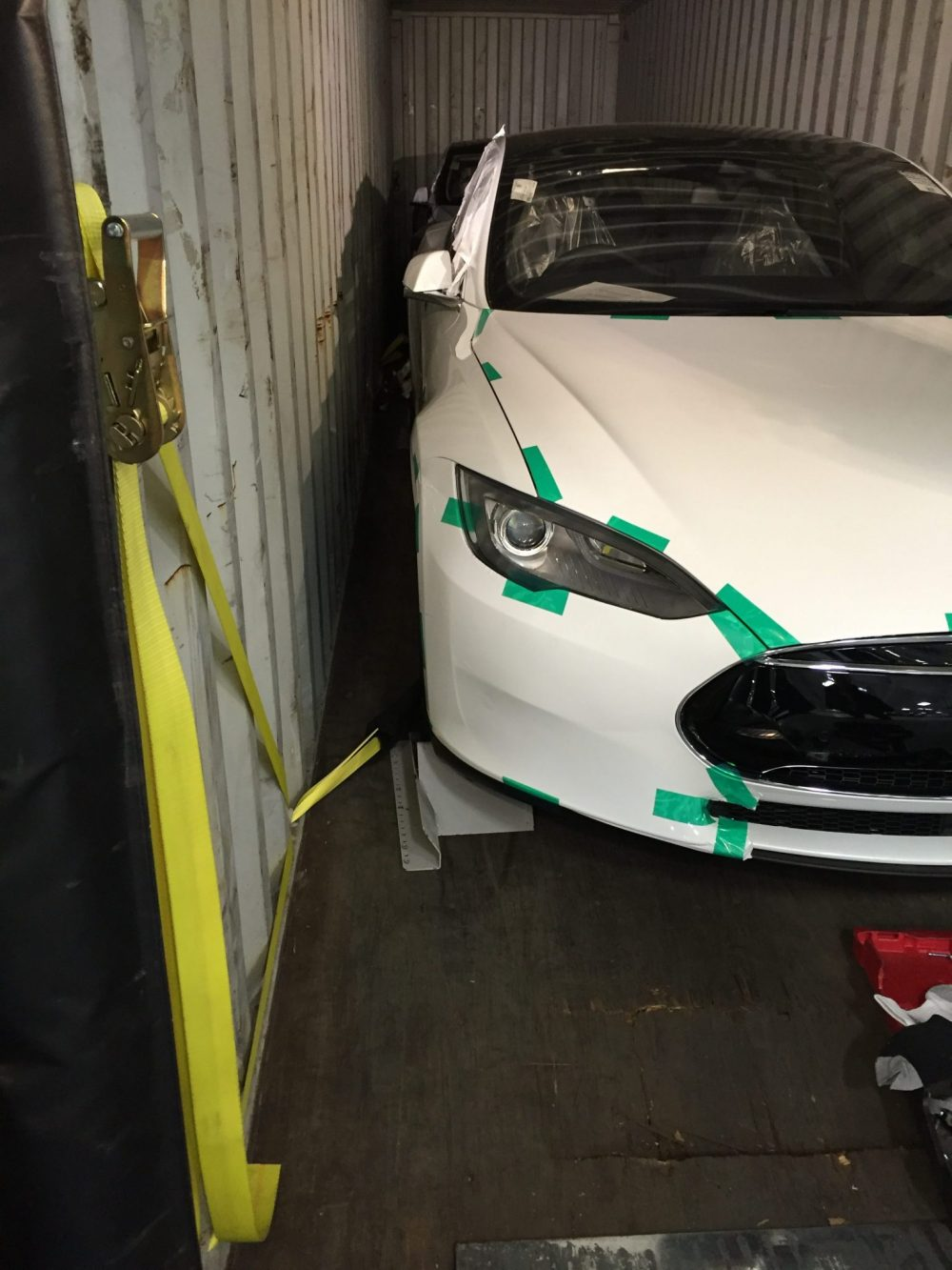 Car in shipping container
