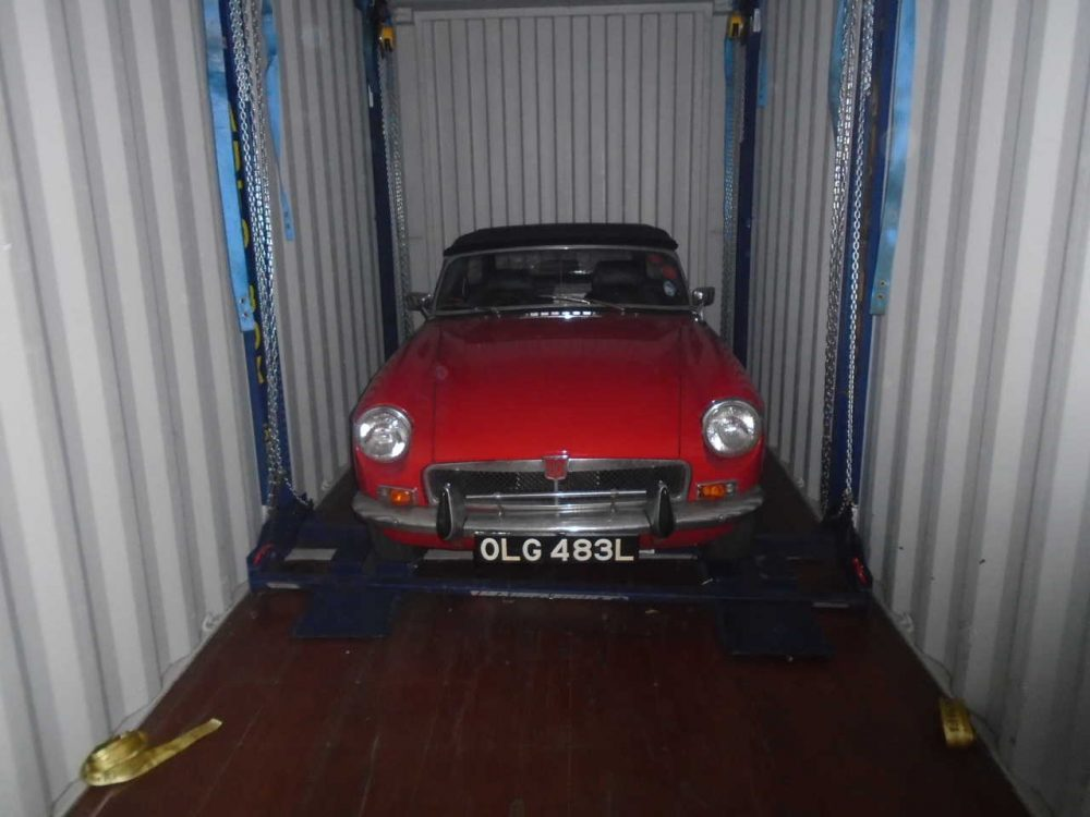 Car in shipping containers