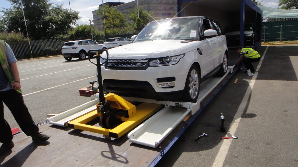 Car going into shipping container