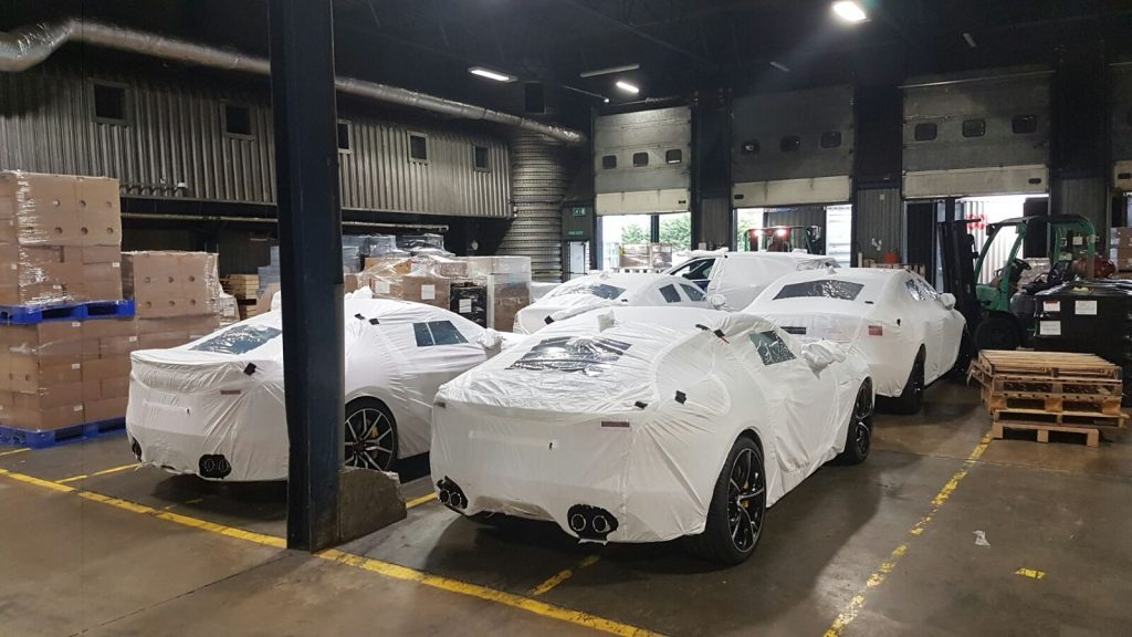 Wrapped Cars in Warehouse
