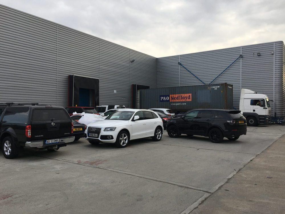 Cars outside warehouse